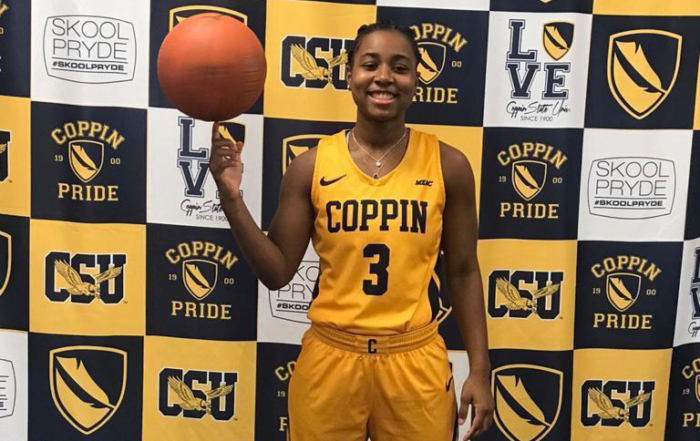 St. Thomian Unique Meyers signs with Coppin State University in Baltimore, Maryland.
