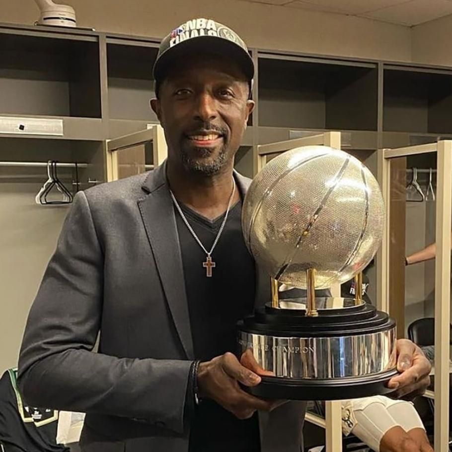 St. Thomas native Milt Newton, the assistant general manager with the NBA's Milwaukee Bucks, holds the Eastern Conference championship trophy in the Bucks' locker room Saturday night after Milwaukee beat the Atlanta Hawks in six games to earn the team's first appearance in the NBA Finals since 1974. The Bucks open their best-of-seven NBA Finals series tonight against the Phoenix Suns in Phoenix.