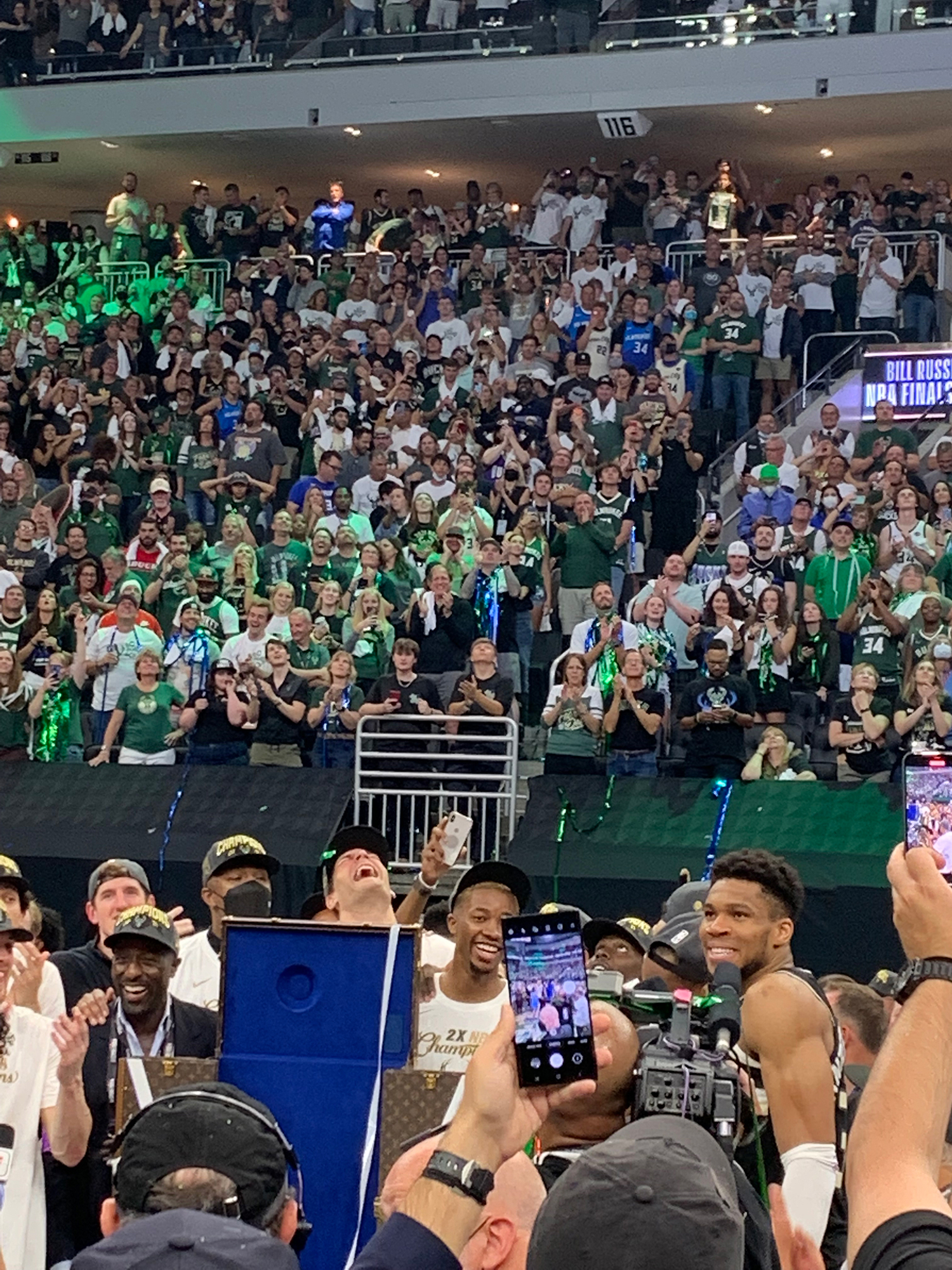 Giannis Antetokounmpo celebrates on the court in front of the crowd after winning the 2021 NBA Championship