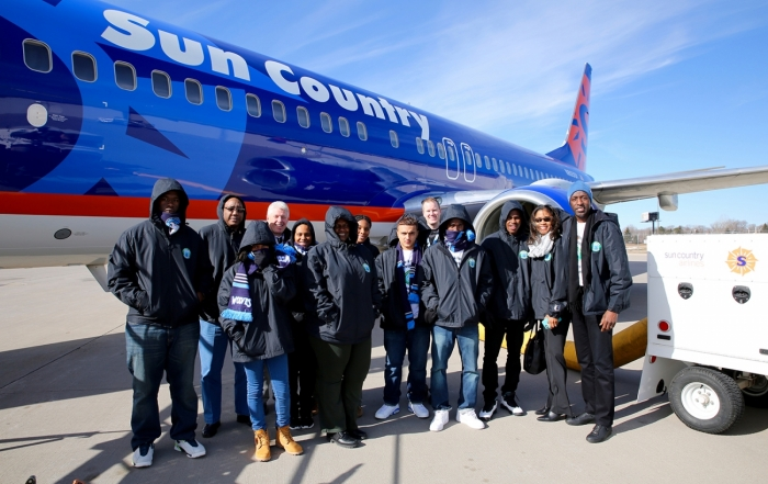 Education-and-Basketball-Enrichment-Program-winners-get-a-behind-the-scenes-look-at-Sun-Country-Airlines-during-visit-to-Minnesota